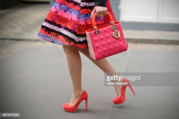 A guest is seen wearing a Dior bag before Dior show on July 7 2014 in Paris France