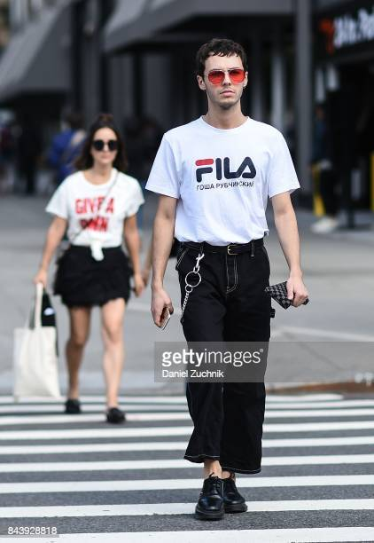 A guest is seen wearing a Fila shirt and black pants outside the Tadashi Shoji show during New York Fashion Week Women's S/S 2018 at Skylight...