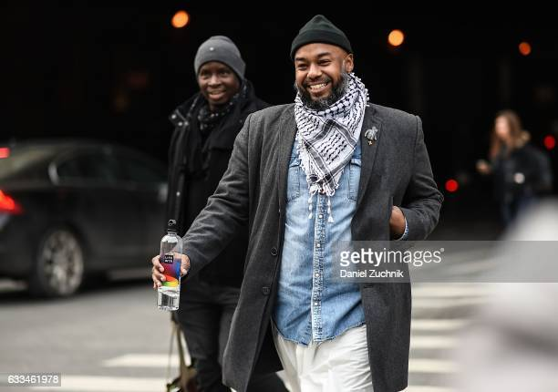 A guest is seen wearing a gray coat blue jean shirt and scarf outside of the Rochambeau show during New York Fashion Week Men's AW17 on February 1...