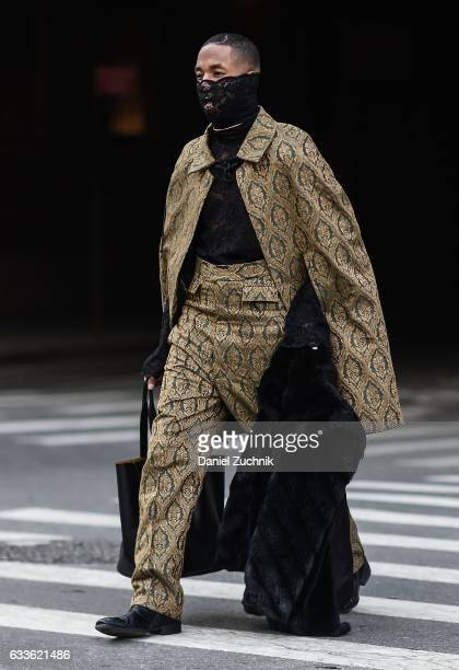 A guest is seen wearing a green and black jacket and pants with black lace top outside of the STAMPD show during New York Fashion Week Men's AW17 on...