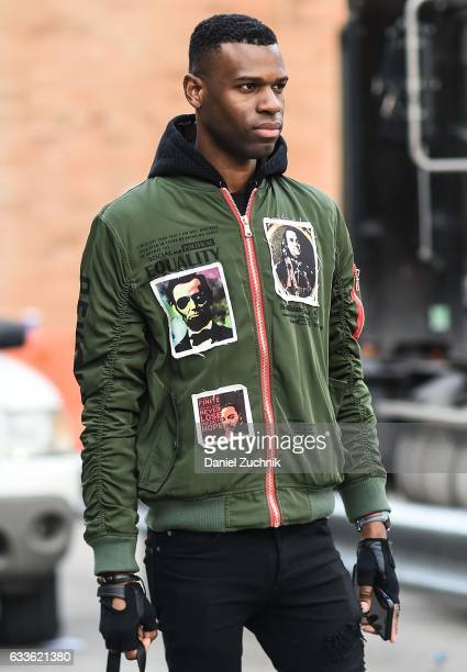 A guest is seen wearing a green patched political jacket outside of the STAMPD show during New York Fashion Week Men's AW17 on February 2 2017 in New...