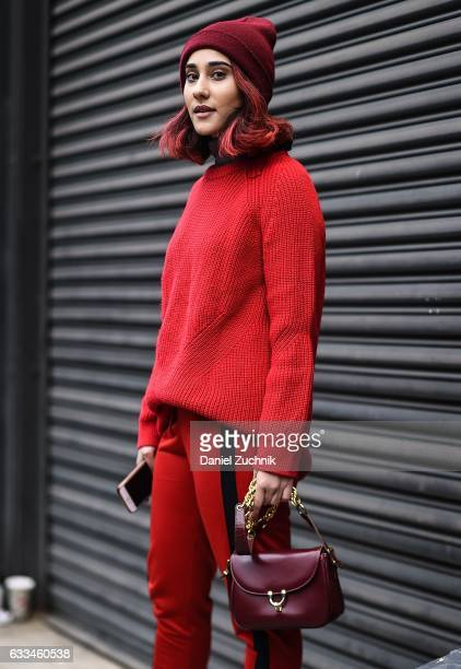 A guest is seen wearing a red sweater red pants and red beanie outside of the Nautica show during New York Fashion Week Men's AW17 on February 1 2017...