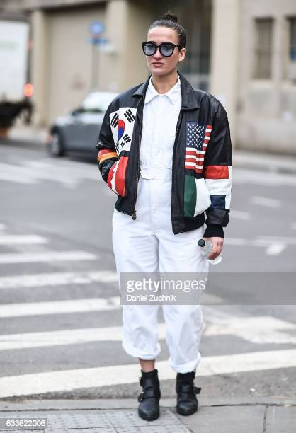A guest is seen wearing a vintage jacket white top and white pants outside of the General Idea show during New York Fashion Week Men's AW17 on...