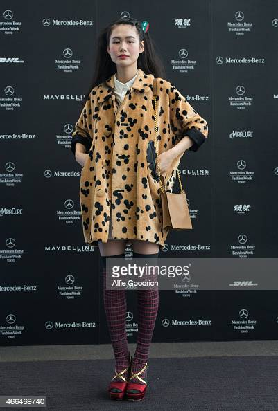 A guest is seen wearing coat by Theatre Product shoes by Prada and bag by Celine during the Mercedes Benz Fashion Week TOKYO 2015 A/W at Shibuya...