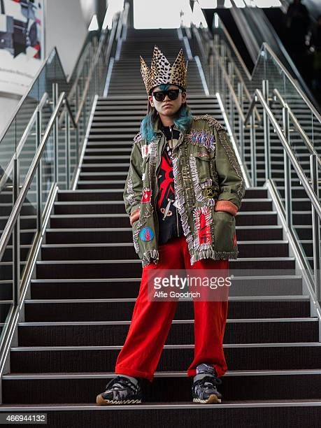 A guest is seen wearing jacket by Anti spectacles by Wild cardigan by Walter and trousers by Garrison during the Mercedes Benz Fashion Week TOKYO...