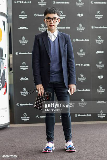 A guest is seen wearing jacket by Initial of Hong Kong shirt by JCrew vintage spectacles trousers by Top Man shoes and clutch by Christian Louboutin...