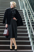 A guest is seen wearing vintage cape and dress selfmade hairpiece and carrying bag by Sybilla of Spain during the Mercedes Benz Fashion Week TOKYO...