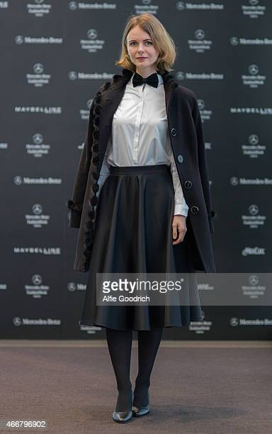 A guest is seen wearing vintage skirt and coat by Armoda during the Mercedes Benz Fashion Week TOKYO 2015 A/W at Shibuya Hikarie on March 19 2015 in...