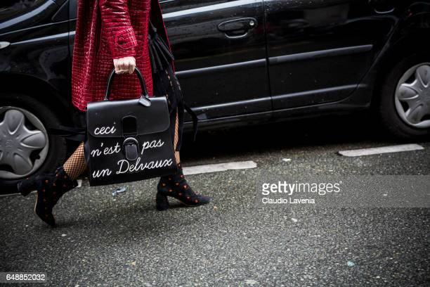A guest is seen with a Delvaux bag after the Veronique Branquinho show during Paris Fashion Week Womenswear Fall/Winter 2017/2018 on March 6 2017 in...