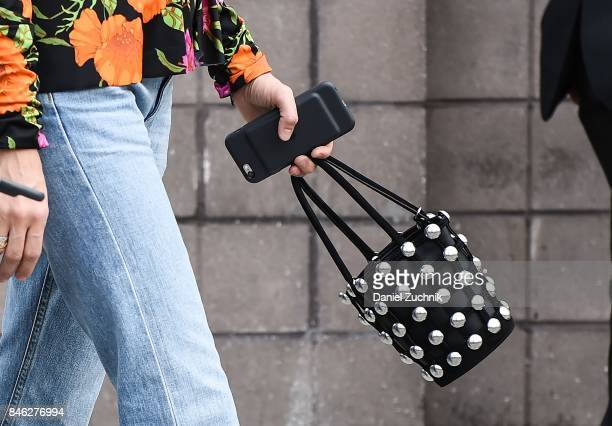 A guest is seen with a purse with pearls outside the Coach show during New York Fashion Week Women's S/S 2018 on September 12 2017 in New York City