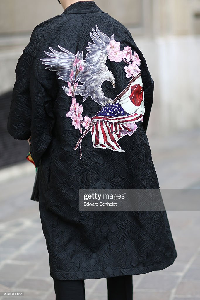 A guest is wearing a black jacket, with a drawing representing an eagle, which is over both Japanese and American flags, before the Paul Smith show, during Paris Fashion Week Menswear Spring/summer 2017, on June 26, 2016 in Paris, France.