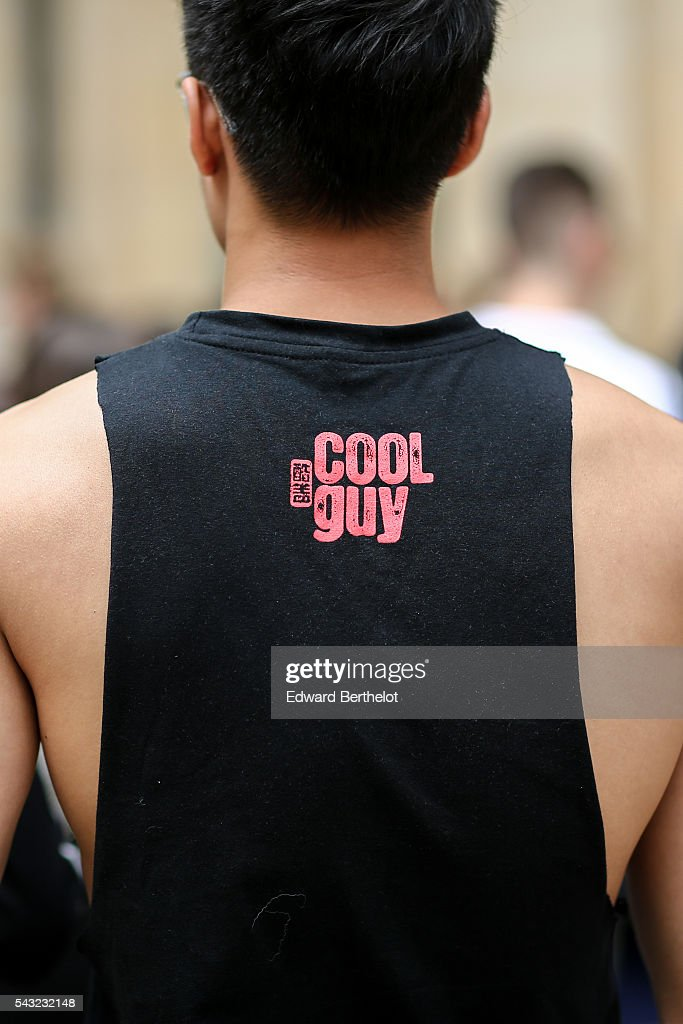A guest is wearing a black top with the inscription 'Cool Guy', before the Sean Suen show, during Paris Fashion Week Menswear Spring/summer 2017, on June 26, 2016 in Paris, France.
