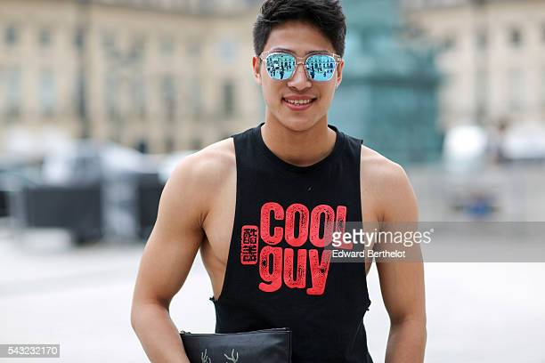 A guest is wearing a black top with the inscription 'Cool Guy' before the Sean Suen show during Paris Fashion Week Menswear Spring/summer 2017 on...