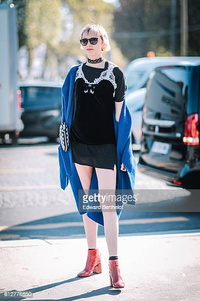 A guest is wearing a blue coat a black top a black skirt and orange shoes outside the Chanel show during Paris Fashion Week Spring Summer 2017 at...