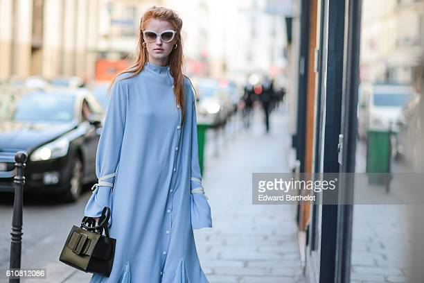 A guest is wearing a blue dress outside the Aalto show on September 27 2016 in Paris France
