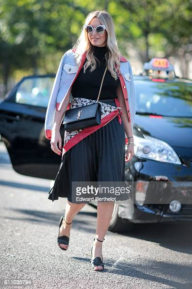 A guest is wearing a Saint Laurent YSL bag outside the Rochas show at the Palais de Tokyo during Paris Fashion Week Spring Summer 2017 on September...
