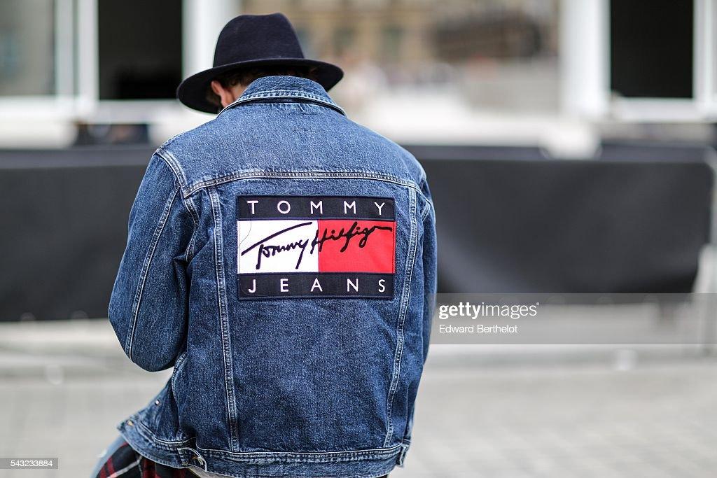 A guest is wearing a Tommy Hilfiger blue denim jacket, before the Sean Suen show, during Paris Fashion Week Menswear Spring/summer 2017, on June 26, 2016 in Paris, France.