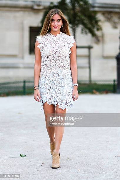 A guest is wearing a white dress outside the Barbara Bui show at Grand Palais during Paris Fashion Week Spring Summer 2017 on September 29 2016 in...