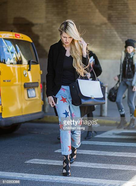 A guest is wearing blue denim jeans with printed stars seen outside Rebecca Minkoff during New York Fashion Week Women's Fall/Winter 2016 on February...