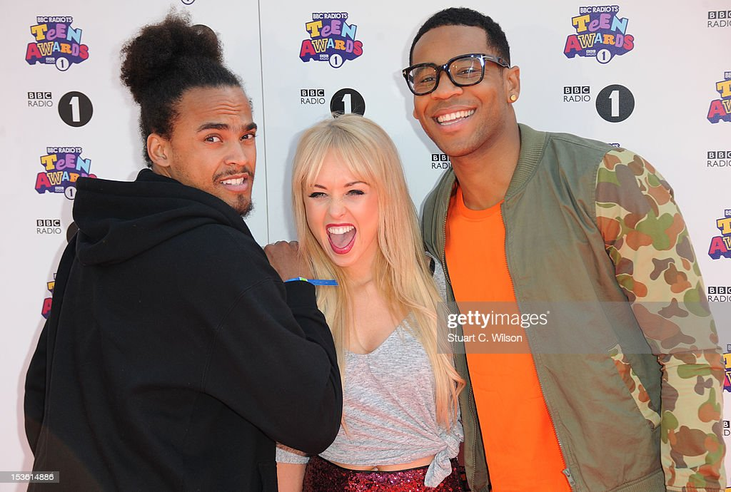 Guest, , Jorgi Porter and <a gi-track='captionPersonalityLinkClicked' href=/galleries/search?phrase=Reggie+Yates&family=editorial&specificpeople=243031 ng-click='$event.stopPropagation()'>Reggie Yates</a> attend the BBC Radio 1 Teen Awards on October 7, 2012 in London, England.