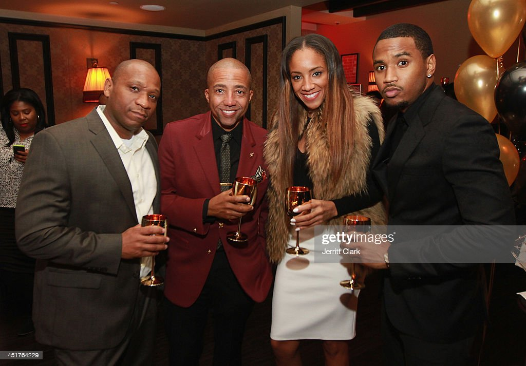 Guest, Kevin Liles, Roe Williams and Trey Songz attend Trey Songz and Fabolous' birthday dinner at Cherry on November 22, 2013 in New York City.