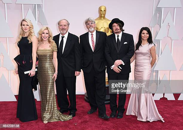 Guest Kim Campbell director James Keach producer Trevor Albert songwriter Julian Raymond and guest attend the 87th Annual Academy Awards at Hollywood...