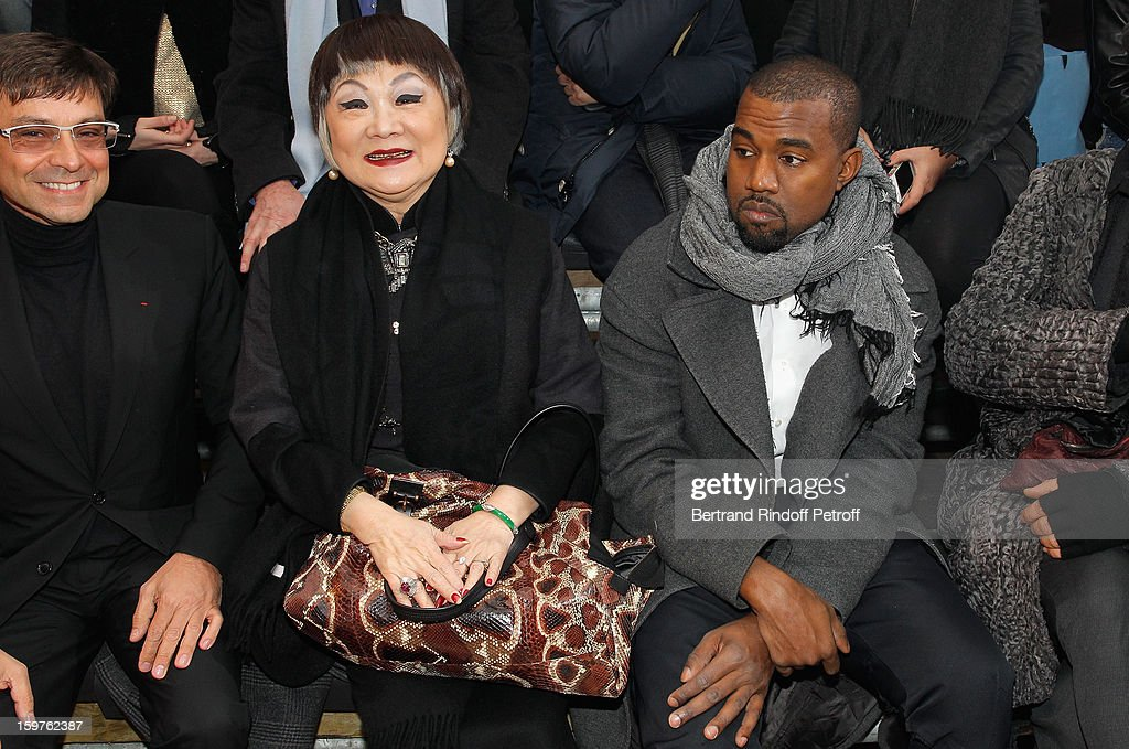 Guest, Lanvin's owner, Shaw Lan Wang and Kanye West attends the Lanvin Men Autumn / Winter 2013 show at Ecole Nationale Superieure Des Beaux-Arts as part of Paris Fashion Week on January 20, 2013 in Paris, France.