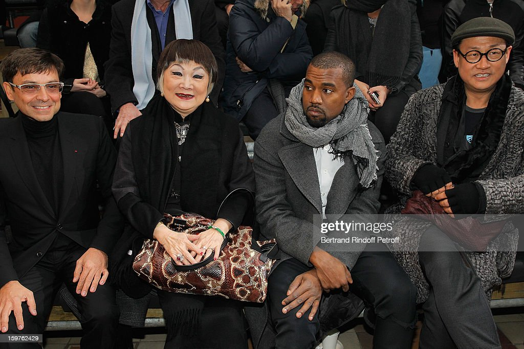 Guest, Lanvin's owner, Shaw Lan Wang, <a gi-track='captionPersonalityLinkClicked' href=/galleries/search?phrase=Kanye+West+-+M%C3%BAsico&family=editorial&specificpeople=201803 ng-click='$event.stopPropagation()'>Kanye West</a> and Alex Koo attend the Lanvin Men Autumn / Winter 2013 show at Ecole Nationale Superieure Des Beaux-Arts as part of Paris Fashion Week on January 20, 2013 in Paris, France.