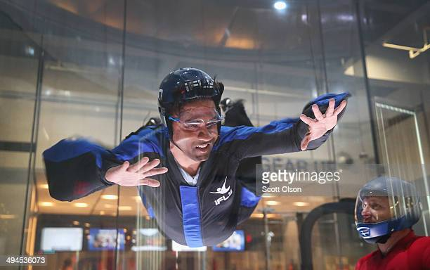 A guest learns how to fly in a wind tunnel at the iFly indoor skydiving facility on May 29 2014 in Rosemont Illinois Guests at the facility are...