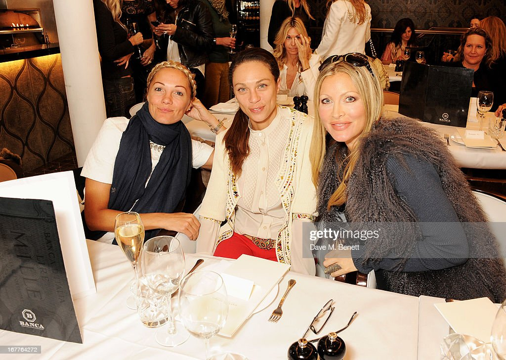 Guest, Lilly Becker and Caprice Bourret attend the launch of Cash & Rocket, in aid of the (Red) Rush to Zero campaign, at Banca Restaurant on April 29, 2013 in London, England.