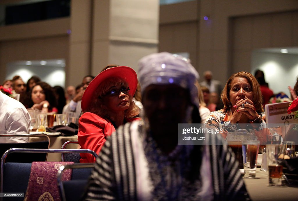 Guest listen as Democratic presidential candidate Hillary Clinton delivers the keynote speech during the Rainbow PUSH Coalition's International Women's Luncheon June 27, 2016 in Chicago Illinois. Clinton addressed gun violence across the country and referred to the Orlando, Florida Pulse nightclub shooting and the uptick in gun crime across Chicago.