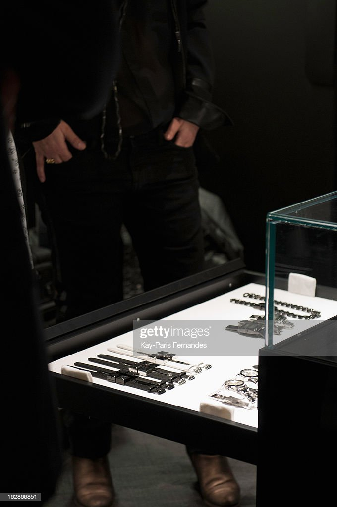 A guest looks at watches on display at the Karl Lagerfeld's Concept Store Opening as part of Paris Fashion Week on February 28, 2013 in Paris, France.