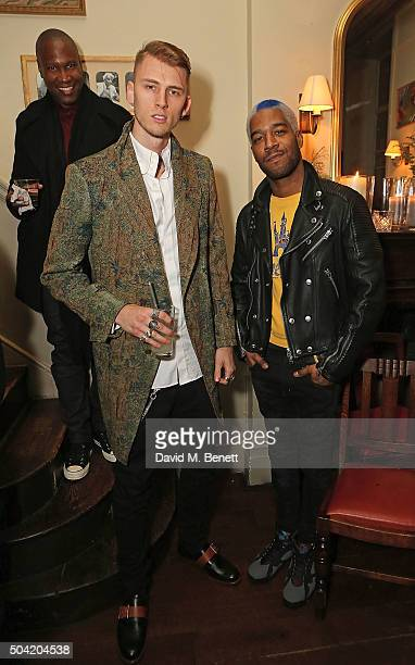 A guest Machine Gun Kelly and Kid Cudi attend COACH Men's Fall/Winter 2016 Party hosted by Stuart Vevers at The Lady Ottoline on January 9 2016 in...