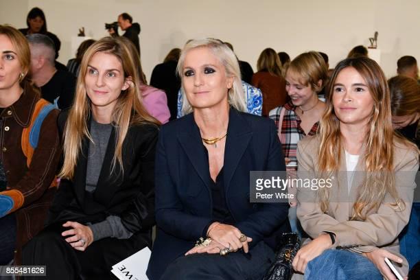 A guest Maria Grazia Chiuri and Miroslava Duma attends the Loewe show as part of the Paris Fashion Week Womenswear Spring/Summer 2018 on September 29...