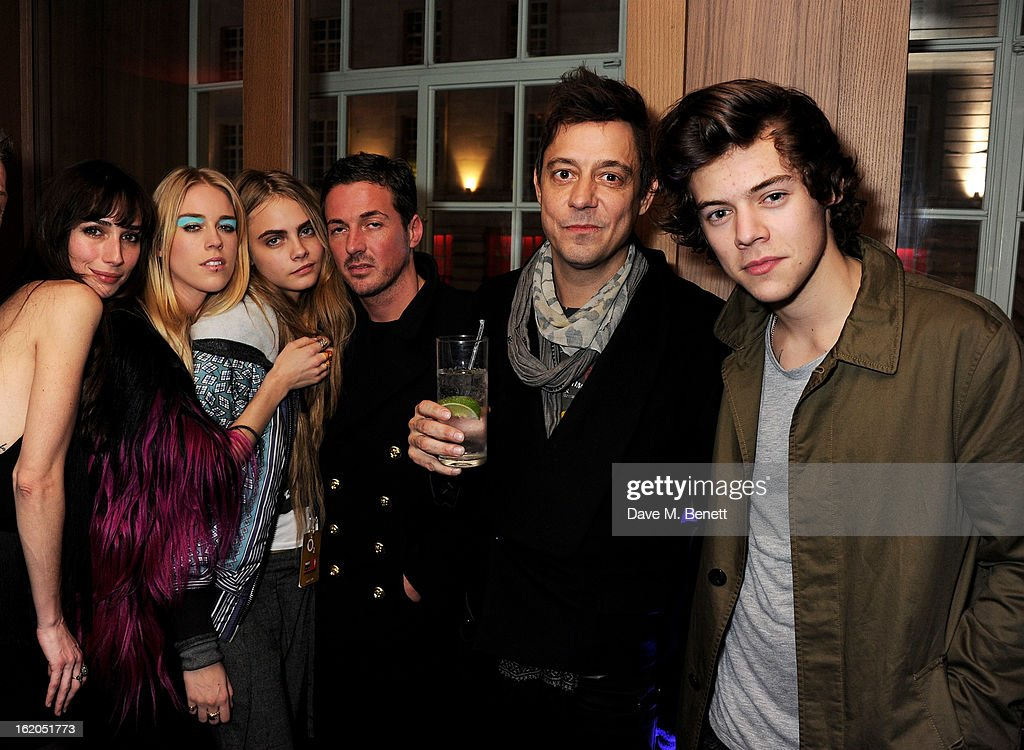 (L to R) Guest, Mary Charteris, Cara Delevingne, Dave Gardner, Jamie Hince and Harry Styles attend the AnOther Magazine and Dazed & Confused party with Belvedere Vodka at the Cafe Royal hotel on February 18, 2013 in London, England.