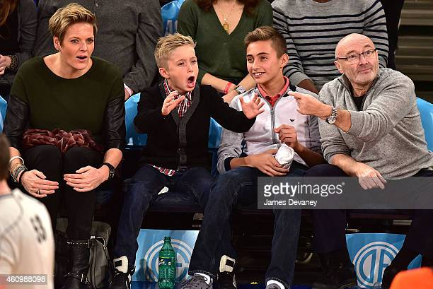 Guest Matthew Collins Nicholas Collins and Phil Collins attend the Detroit Pistons vs New York Knicks game at Madison Square Garden on January 2 2015...