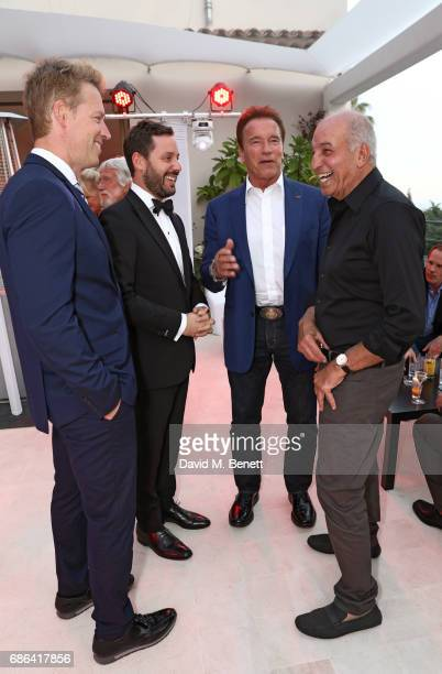 guest Michael Kives Arnold Schwarzenegger and David Reuben attend a dinner hosted by Jamie Reuben Michael Kives with Arnold Schwarzenegger to...