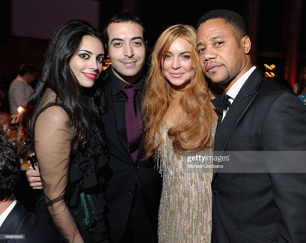 Guest, Mohammed Al Turki, Lindsay Lohan, and Cuba Gooding Jr. attend the amfAR New York Gala to kick off Fall 2013 Fashion Week at Cipriani Wall Street on February 6, 2013 in New York City.