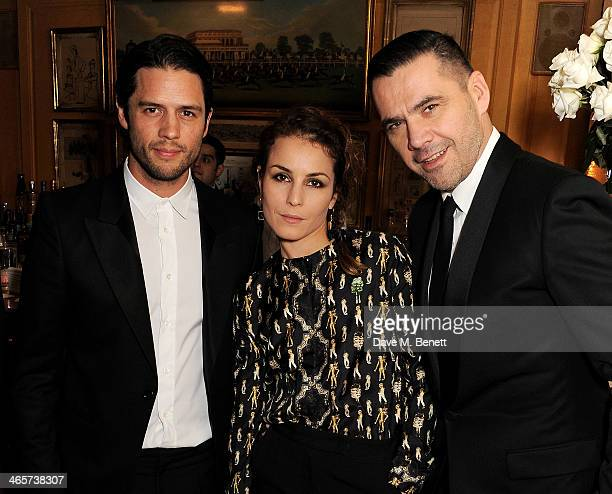Guest Noomi Rapace and Roland Mouret attend the Charles Finch and Chanel PreBAFTA cocktail party and dinner at Annabel's on February 8 2013 in London...