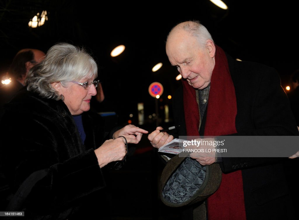 Guest of honour French actor Michel Bouquet (R) signs an autograph upon his arrival during Valenciennes Film Festival on March 20, 2013 in Valenciennes, northern France. Valenciennes Film Festival runs from March 18 to 24.