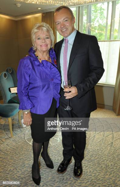 Guest of honour Graham Norton poses with President Emeritus Judith Chalmers during a tribute lunch hosted by The Lady Taverners at the Dorchester...