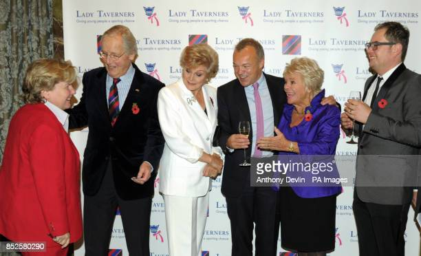 Guest of honour Graham Norton poses with Sandy Toksvig Nicholas Parsons Angela Rippon President Emeritus Judith Chalmers and Alan Carr during a...