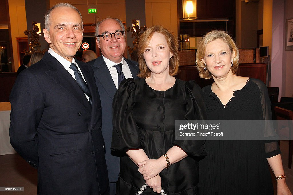 Guest, Olivier Merveilleux du Vignaux, Cecile David-Weill and Nathalie Merveilleux du Vignaux attend a dinner in honor of Helene David-Weill, who presided through 1994 - 2012 Les Arts Decoratifs, one of the largest decorative arts museums in the world, at Sotheby's on January 28, 2013 in Paris, France.