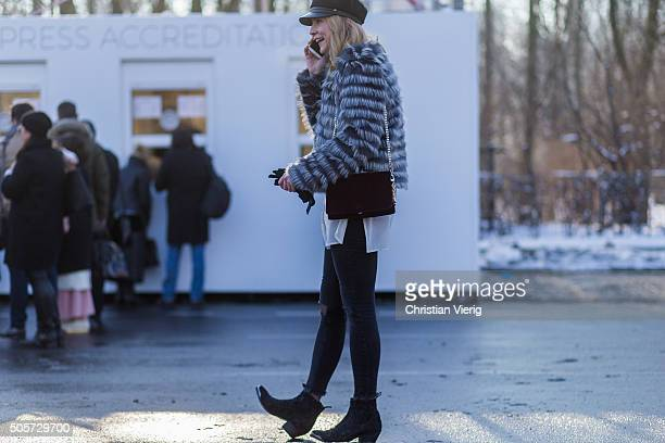 A guest outside Lena Hoschek during the MercedesBenz Fashion Week Berlin Autumn/Winter 2016 at Brandenburg Gate on January 19 2016 in Berlin Germany