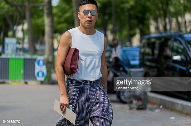 A guest outside Rick Owens during the Paris Fashion Week Menswear Spring/Summer 2017 on June 23 2016 in Paris France