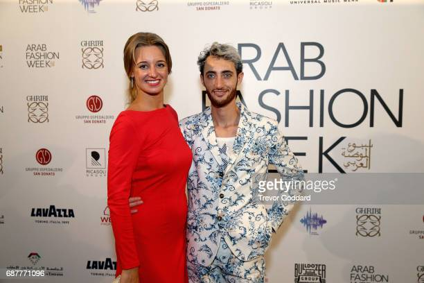Guest pose with Jacob Abrian at the Arab Fashion Week Ready Couture Resort 2018 Gala Dinner on May 202017 at Armani Hotel in Dubai United Arab...