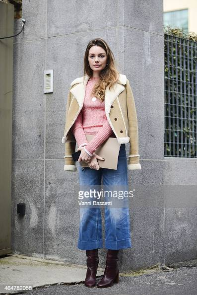 A guest poses after Bottega Veneta show on February 28 2015 in Milan Italy