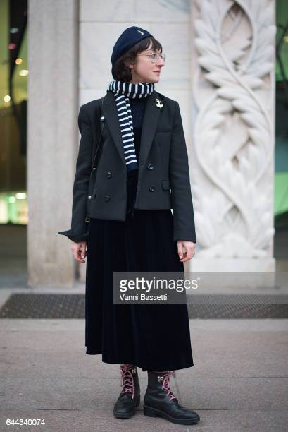 A guest poses after the Angel Chen show during Milan Fashion Week Fall/Winter 2017/18 on February 23 2017 in Milan Italy