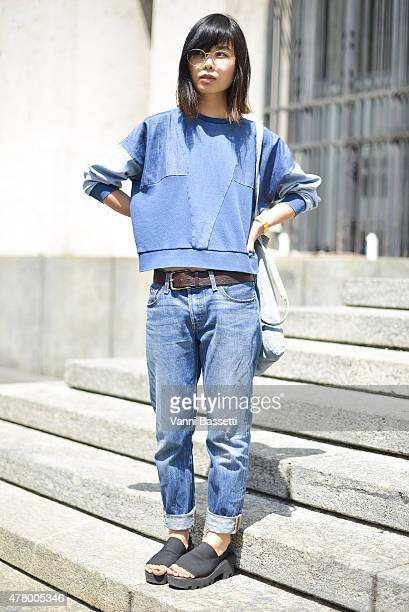 A guest poses before Ferragamo show on June 21 2015 in Milan Italy