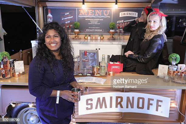A guest poses for a photo in front of the Smirnoff Copper Truck with her complimentary Smirnoff Moscow Mule Mug during the 2016 New York Taste...